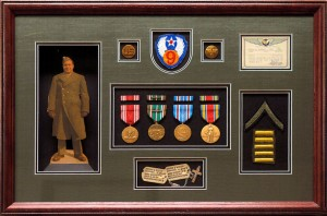 Sample image of what we do at Timeless Custom Frames & Art Gallery. Sure you can frame a flag in flag frame - but if you want to tell your story, we recommend a shadowbox custom frame.